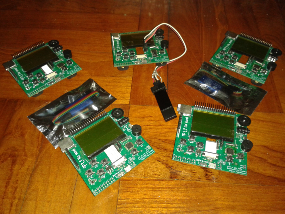 A photo showing 5 game consoles with 3 ST-Link programmers
