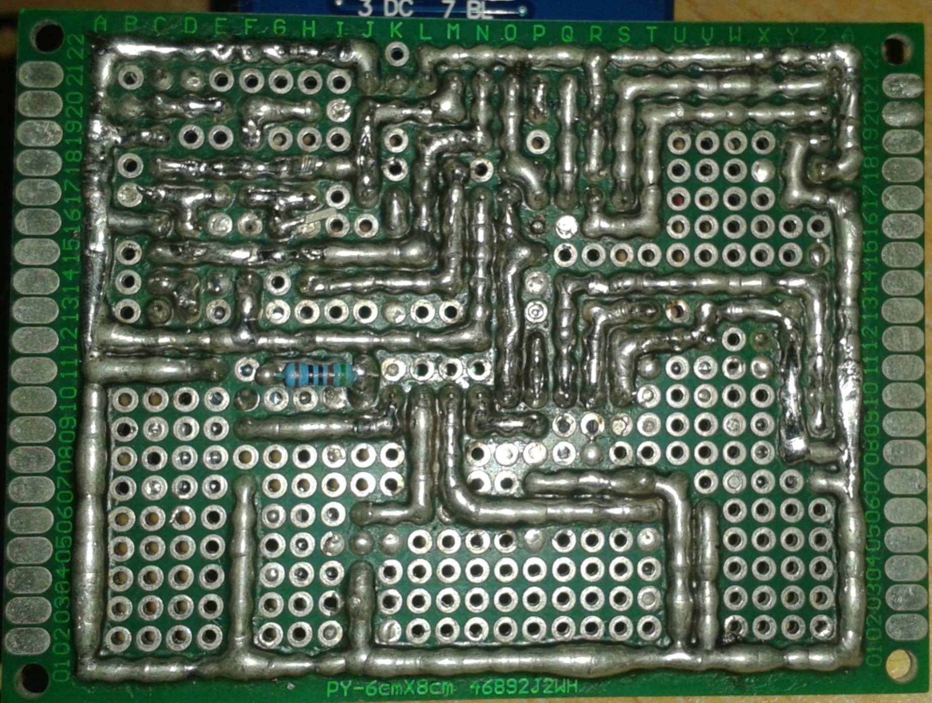 Photo of the back of the portable game console, showing the soldering trace on perfboard