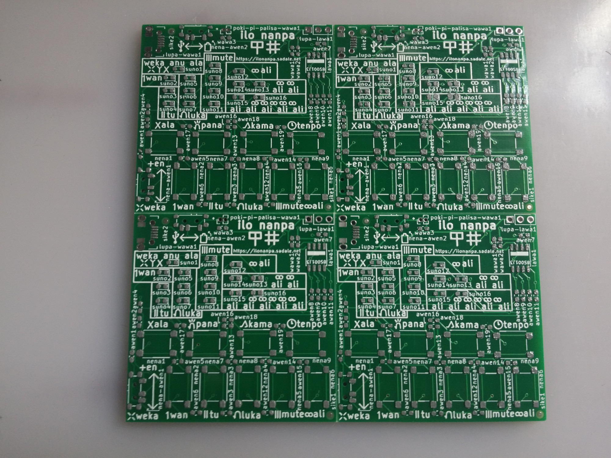 A photo showing PCB with solder paste on all of its pads